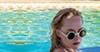 Dakota Johnson dons Lolita sunglasses in <i>A Bigger Splash</i>.