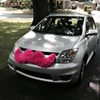 A Lyft car with its trademark pink mustache.