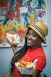 Tiffany Wiley of Riko's Kickin' Chicken shows off their popular wings.