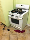The kitchen in the Midtown guest house Moore shared with McLemore became the scene of an attack.