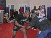 UFC Champ Quinton Jackson wrangles with a training partner at Mullen's Karate