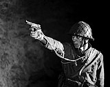 Unfriendly fire: A Japanese soldier threatens deserters.