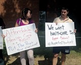 United Campus Workers demand Medicaid expansion during Bill Haslam's recent visit to Memphis. - BIANCA PHILLIPS