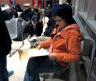 Volunteer Jane Hooks surveys a homeless person at a MATA terminal. - BIANCA PHILLIPS