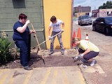 Volunteers prepare the Edge District for MEMFix fest.