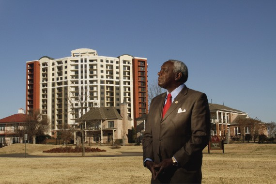 Walter Bailey, resident of Founders Pointe, with the unfinished Horizon rising in the background