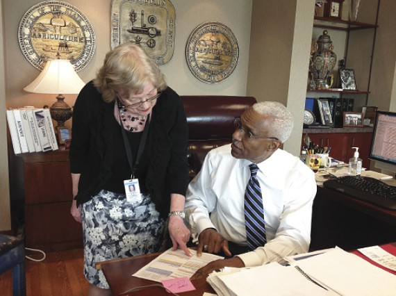 Wharton and his assistant Lois Riseling go over his schedule.