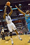 Zach Randolph had his rainbow baseline jumper working as the Grizzlies clinched another playoff bid.