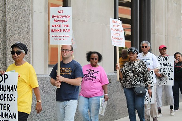 A coalition of activists protests outside the Detroit Water & Sewerage Department's office in downtown Detroit on Friday, June 6, 2014. - RYAN FELTON/MT