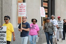 PHOTO BY RYAN FELTON. - A coalition of activists protests residential water shut-offs outside of the Detroit Water & Sewerage Department's office in downtown Detroit on Friday, June 6. The department increased the number of delinquent accounts it planned to shut off in order to recoup some $118 million in outstanding fees.
