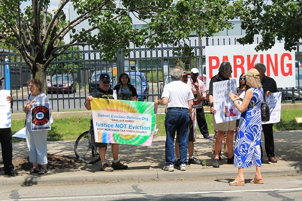 A group of Detroit residents and the Detroit Eviction Defense Coalition gathered in New Center on July 11, 2014 to protest against an Oakland County developer currently locked in a court case with those residents. (Ryan Felton / Metro Times)