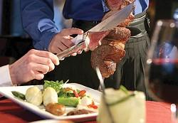 A server cuts picanha (sa Brazilian rump roast) at Gaucho Brazilian Steakhouse. - MT PHOTO: ROB WIDDIS
