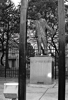 Activist priest Fr. Clem Kern�s statue is in locked pocket park.