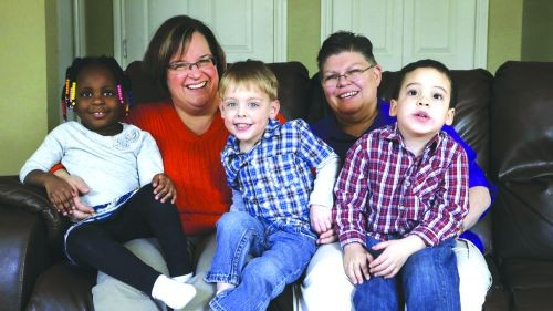 April DeBoer and Jayne Rowse, who are challenging Michigan's ban on same-sex adoption, with their three 'foster' children.