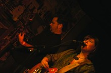 Bassist Mike Shellabarger (left) and country crooner Carrie Shepard (right) of the Whiskey Charmers. - CHRIS CUNNINGTON