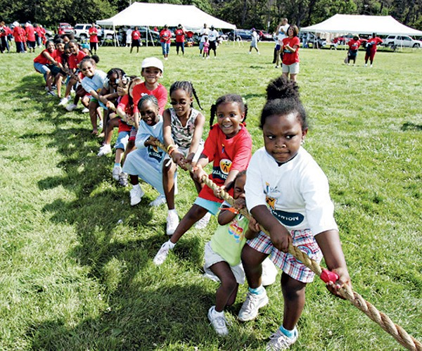 Belle Isle tug-of-war and the MLK High School marching band during past Neighborhoods Days.