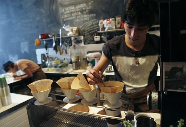 Ben Saginaw prepares pour over drip coffee at Astro Coffee in Detroit. - PHOTO: ROB WIDDIS
