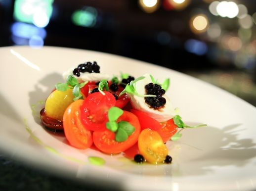 """Buffalo Mozzarella with heirloom tomatoes, basil oil and balsamic """"pearls,"""" from Cafe ML in Bloomfield Township."""