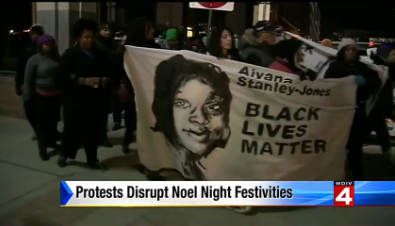 "By the way, big ups to WDIV newscaster Priya Mann for declaring that ""there were no arrests; this was a very peaceful protest,"" despite WDIV's caption implying otherwise. - SCREENGRAB FROM WDIV NEWS"