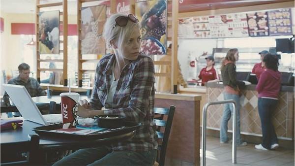 Charlize Theron subverts her super-pinup sassafras.