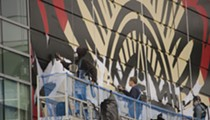 Check out these photos of Shepard Fairey's mural in progress