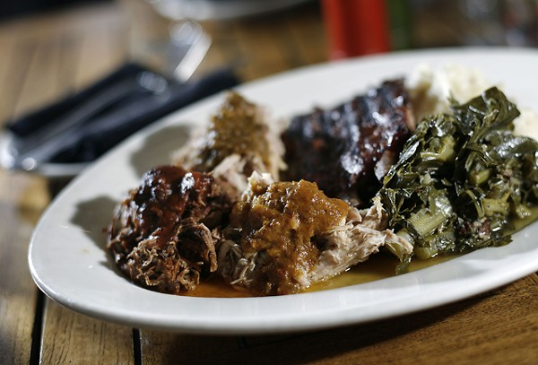 "Chef Alex's ""Bearded BBQ Plate,"" with Memphis-style ribs, barbecued beef, South Carolina pulled pork, pit-smoked chicken, with mashed local potatoes and bacon-braised greens from Zingerman's Roadhouse in Ann Arbor."
