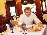 Chef/owner Paul Grosz serves steamed lobster with lobster ravioli. - METRO TIMES PHOTO / LARRY KAPLAN
