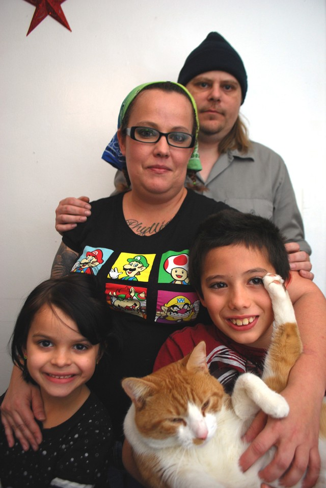 Christina Walsh and Danny Browning with Lyllie and Luther inside their apartment.