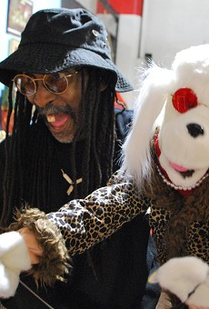 Darrell Banks lip-syncing with his puppet Diamond inside his booth.