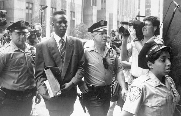 Defendant Yusef Salaam being escorted by police in 1990. The media circus was part of the problem.