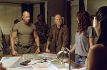 Dwayne Johnson (left) and Bruce Willis are held prisoner by the military-Hollywood complex.