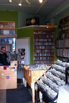 Flipping through records at Ann Arbor's Underground Sounds