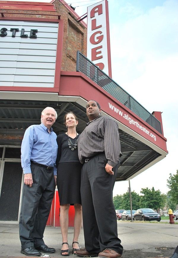 Geoff Gowman, Helen Broughton and Conroy Jointer in front of their beloved theater.