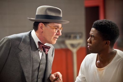 In 42, Harrison Ford is Dodgers manager Branch Rickey to Chadwick Boseman's Jackie Robinson.