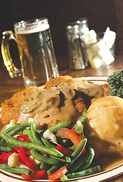 Jager Schnitzel: Breaded pork cutlet with mushroom sauce and vegetables. - MT PHOTO: ROB WIDDIS