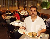 Jennifer's Cafe: Owner/chef Jack Suidan serves Maurice salad and salmon Florentine. - METRO TIMES PHOTO / LARRY KAPLAN