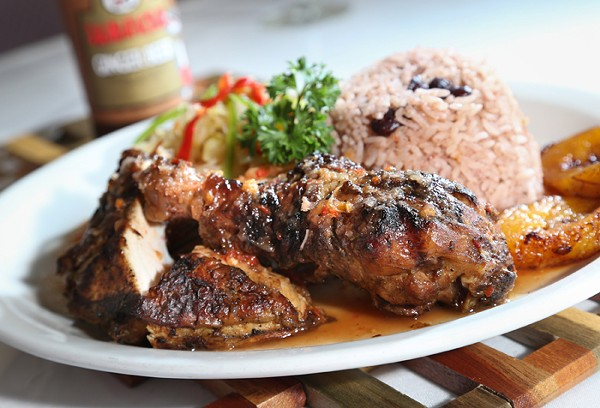 Jerk Chicken with sides of cabbage, peas and rice, and plantains from Jamaican Paradise in Oak Park. - PHOTO BY ROB WIDDIS.