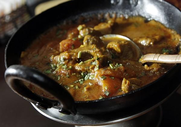 "Karai lamb and ""Chicken Tikka Masala Sizzler,"" from Mazza Indian Cuisine in Berkley."
