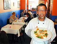 L.A. Express' owner-chef, Michael Chamas, serves chicken lasagna. - METRO TIMES PHOTO / LARRY KAPLAN
