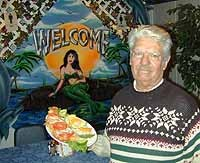 Mariscos co-owner Jesus Servin serves filet of catfish with rice - METRO TIMES PHOTO / LARRY KAPLAN