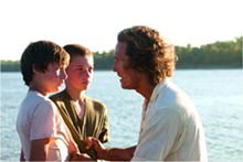 Matthew McConaughey, with Tye Sheridan and Jacob Lofland, are hiding from the law along the Mississippi River in Mud.