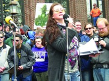 Michigan Moms United founder Charmie Gholson speaking at Hash Bash in Ann Arbor.