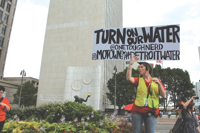 More than 1,000 people took to the streets of downtown Detroit to demonstrate against the city's ongoing water shutoffs on July 18, 2014. The protest was organized by the National Nurses United. - RYAN FELTON/METRO TIMES