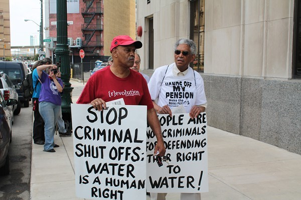 A coalition of welfare rights groups rally outside of the Detroit Water & Sewerage Department's main office at 735 W. Randolph in downtown Detroit on Friday, June 6. The groups were protesting efforts by the city to cut water service to residential customers with $150 or more in outstanding fees. - RYAN FELTON/METRO TIMES