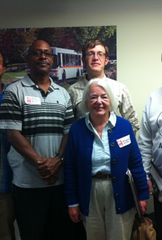 "A group of metro Detroit residents wearing ""Bring Back the Buses"" stickers attended a meeting of the Suburban Mobility Authority for Regional Transportation's board of directors on Sept. 25, 2014, to ask for more frequent service along Woodward Avenue."