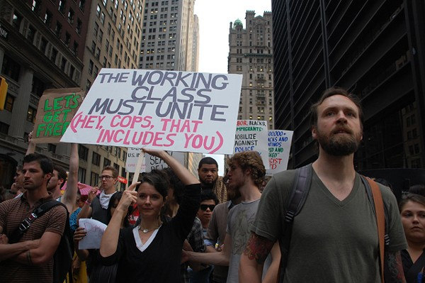 """Occupy Wall Street protesters head up Broadway last Friday. A reflection of people """"fed up"""" with their nation's direction, says Maria Svart, head of the Democratic Socialists of America."""