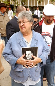 On the wrong end of the clampdown on medical marijuana: Barb Agro with a photo of her late husband, Sal.
