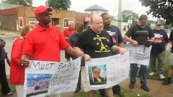 Photo cutline: Representatives from the Detroit Eviction Defense and Detroit Residents protested outside a Singapore-based real estate firm's office in Pontiac on July 24, 2013, arguing for certain home listings to be removed. (Courtesy Detroit Eviction Defense)