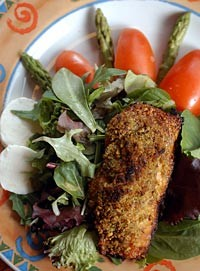 Pistachio Salmon Salad from Union Street in Detroit features baked, pistachio-crusted Atlantic salmon served on a bed of organic mixed greens. - METRO TIMES PHOTO/ROB WIDDIS