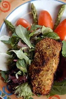 Pistachio Salmon Salad from Union Street in Detroit features baked, pistachio-crusted Atlantic salmon served on a bed of organic mixed greens.
